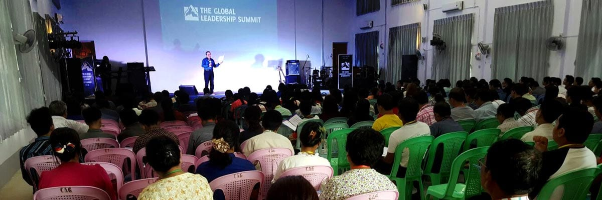 A Global Leadership Summit site in Myanmar listens to the local host outline the leadership themes for the day.