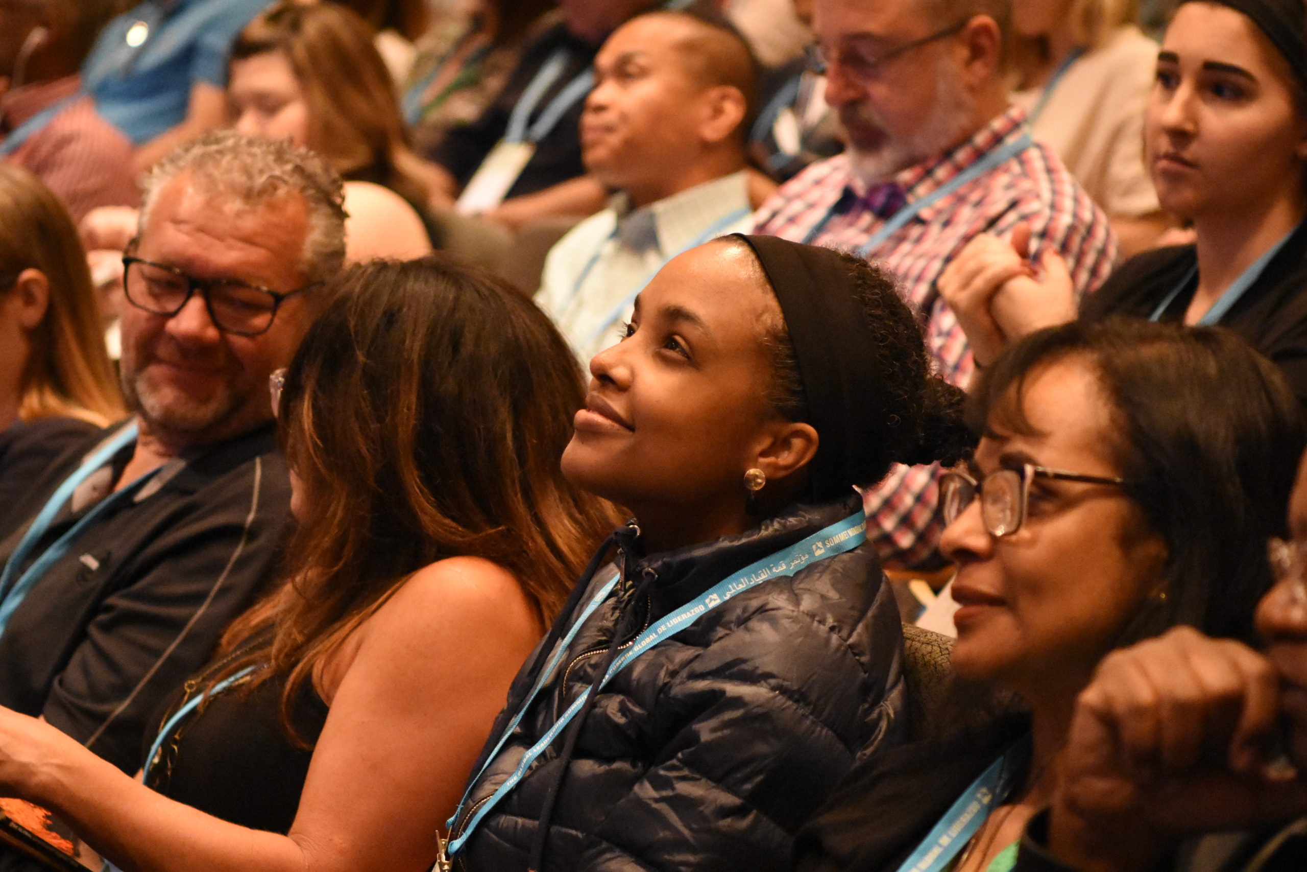 Woman in audience watching the GLS